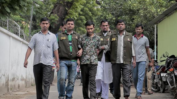 Bangladesh detectives escort a man who they have identified as Shariful Islam Shihab, a former member of the banned Islamic group Harkatul Jihad (AP)