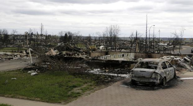 Property damaged by wildfire in Fort McMurray, Alberta (Rachel La Corte/The Canadian Press via AP)