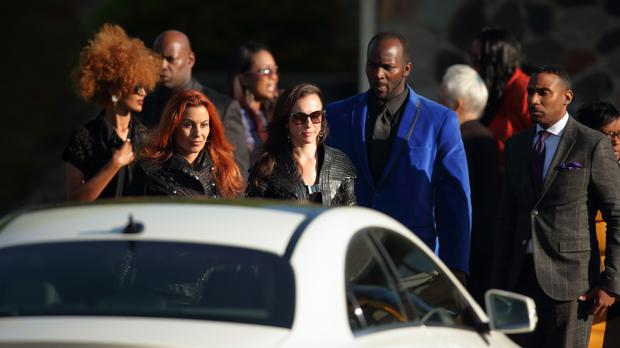 Mourners leave the Kingdom Hall following the memorial service for Prince in Minnetonka, Minnesota (Jeff Wheeler/Star Tribune via AP)