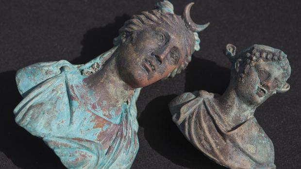 Rare bronze artefacts were among those found (AP)