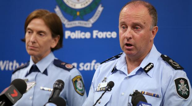 Australian Federal Police acting deputy commissioner Neil Gaughan and New South Wales deputy commissioner Catherine Burn announce the terror arrest (AP)