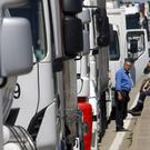 Truck drivers block the road near Fos-sur-Mer in southern France (AP)