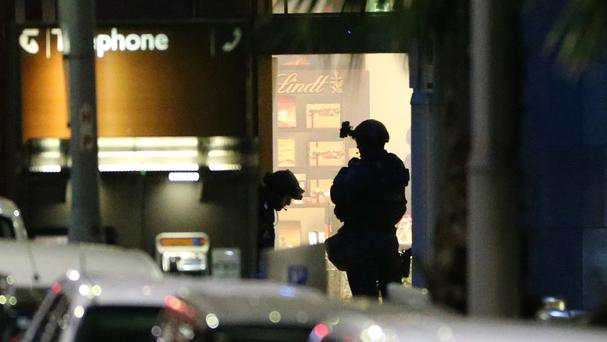 Armed tactical response officers stand ready to enter the Lindt cafe in Sydney during the siege in December 2014 (AP)
