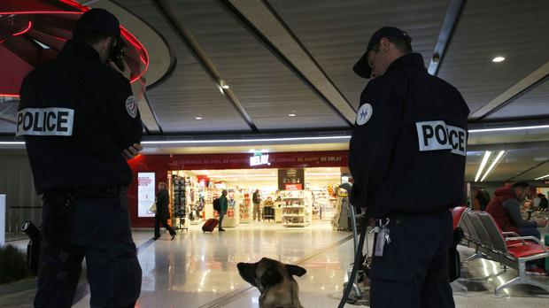 Police officers on patrol at Charles de Gaulle airport in Paris (AP)