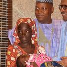 President Muhammadu Buhari, third right, meets rescued Chibok schoolgirl Amina Ali, far left, and her four-month-old baby (AP)