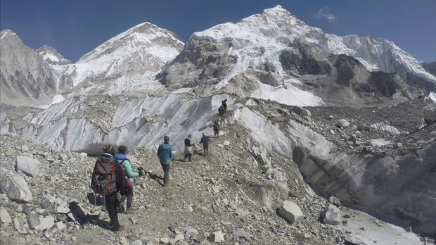 Trekkers pass through a glacier at the Mount Everest base camp (AP)