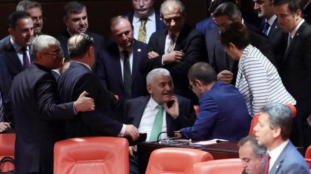 Binali Yildirim, centre, is expected to be the next prime minister (AP)
