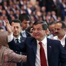 Ahmet Davutoglu salutes supporters during the party congress in Ankara (AP)