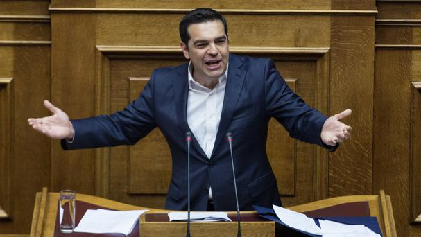 Prime Minister Alexis Tsipras addresses politicians in Greece's parliament ahead of a Eurogroup meeting next week which is likely to unlock bailout funds for the country (AP)