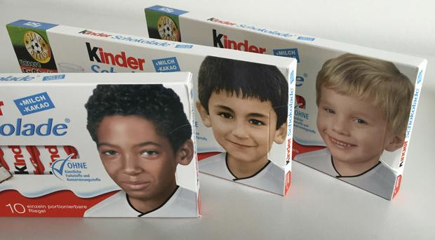 Childhood pictures of Jerome Boateng, Ilkay Gundogan and Polish born Lukas Podolski replace the usual blond boy on the packaging (AP)