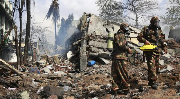 Indian rescue workers at the site of an explosion at a chemical factory in Dombivli (AP)