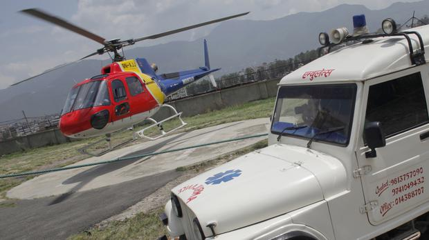 A helicopter carrying the body of Dutch climber Eric Arnold, who died on Mount Everest, lands in Kathmandu, Nepal (AP)