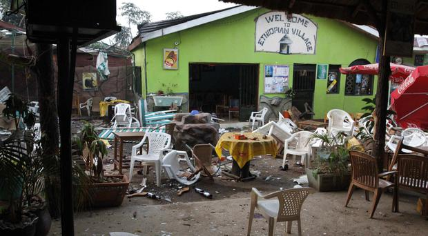 Damage after a bomb attack outside the Ethiopian Village restaurant in Kampala, Uganda (AP)