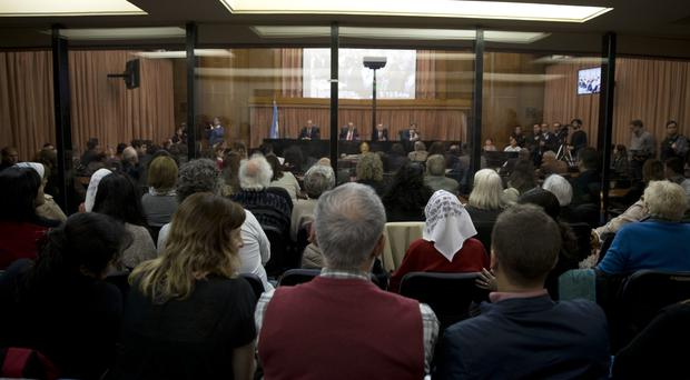 People sit in federal court for the sentencing of former military officers in Buenos Aires, Argentina (AP)
