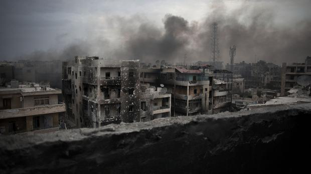 Smoke rises over Saif Al Dawla district, in Aleppo, Syria (AP)