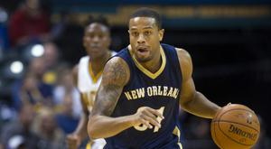 Bryce Dejean-Jones, pictured playing for the New Orleans Pelicans last October, was shot dead after breaking down the door of a Dallas flat (AP)