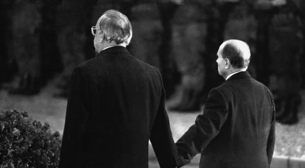 Late French President Francois Mitterrand (right) and German Chancellor Helmut Kohl stand hand in hand in 1984 at a ceremony for the Battle of Verdun (AP)