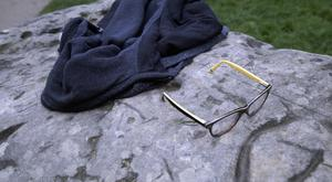 A child's glasses and a jacket lie on a rock in Park Monceau, after the lightning strike in Paris (AP)