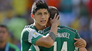 Footballer Alan Pulido has been rescued by authorities after being kidnapped in Mexico (AP)