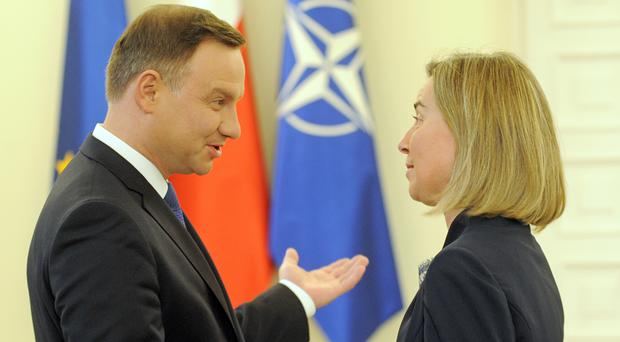 Polish President Andrzej Duda meets EU foreign affairs chief Federica Mogherini in Warsaw, Poland (AP)