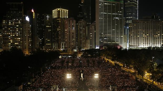 Tens of thousands of people attend a candlelight vigil in Hong Kong (AP)