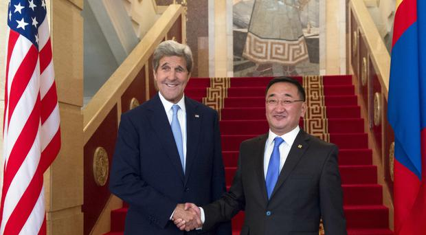 John Kerry meets Mongolian foreign minister Lundeg Purevsuren during his visit to Ulaanbaatar (Pool photo/AP)