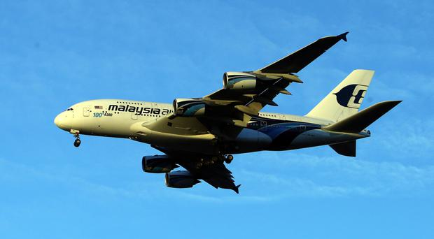 A Malaysia Airlines Airbus A380-841 plane