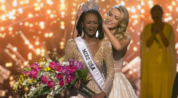 Miss District of Columbia Deshauna Barber is crowned Miss USA by Miss USA 2015 Olivia Jordan (Las Vegas Review-Journal /AP)