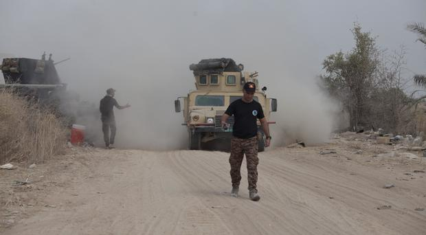 Iraq's elite counter-terrorism forces move their vehicles on the front line in Fallujah (AP)