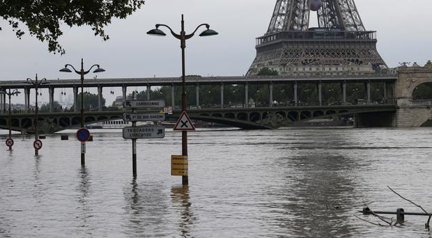 The banks of the Seine river next to the Bir Hakeim bridge and the Eiffel Tower (AP)