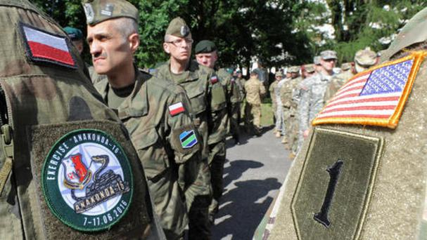 Polish Army and US Army soldiers attend the opening ceremony of the Anaconda-16 military exercise, in Warsaw (AP)