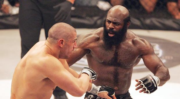 Kimbo Slice, right, battling James Thompson during their EliteXC heavyweight bout (AP)