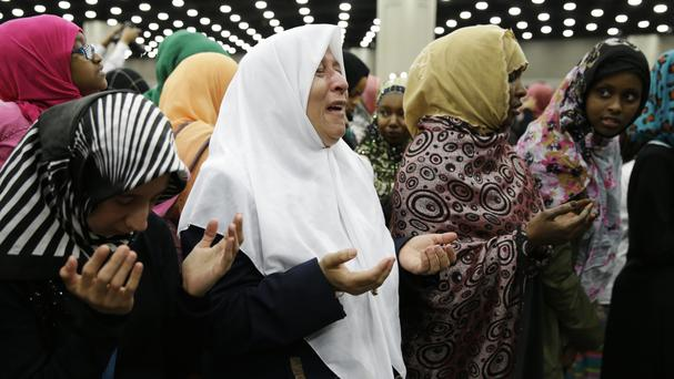 Women pray before Muhammad Ali's Jenazah, a traditional Islamic Muslim service, in Freedom Hall, Louisville (AP)