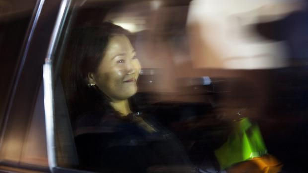 Keiko Fujimori smiles as she is driven from a local campaign house in Lima (AP)
