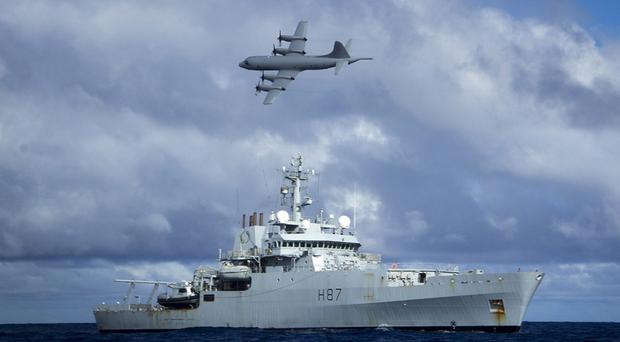 HMS Echo and a Lockheed P-3 Orion searching the southern Indian Ocean for the missing Malaysia Airlines flight