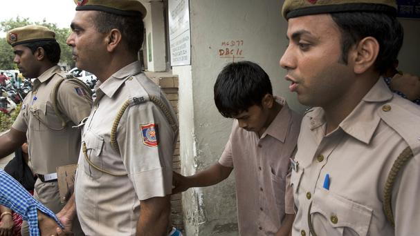 One of the five convicted men in the gang rape is escorted from court by police in New Delhi (AP)