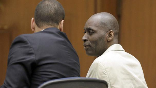 Michael Jace with his lawyer at Los Angeles County Superior Court (AP)