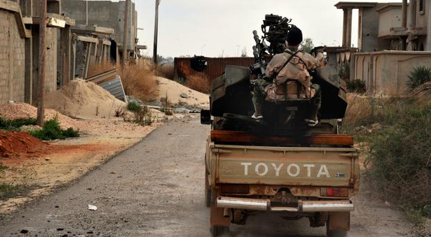Libya's pro-government forces have taken control of the Islamic State's main bastion Sirte (AP)