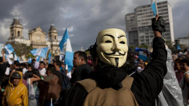 A demonstrator at a protest against corruption outside the National Palace in Guatemala City (AP)