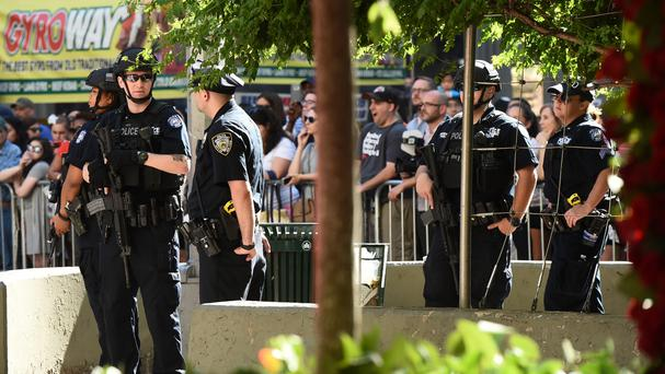 Police officers stand guard outside the Tony Awards at the Beacon Theatre (AP)