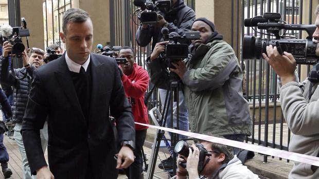 Oscar Pistorius arrives at the High Court in Pretoria, South Africa, for his sentencing hearing (AP)