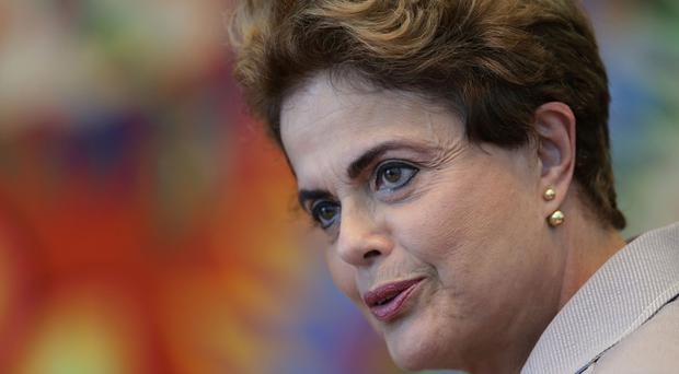 Suspended Brazilian President Dilma Rousseff speaks during a press conference for foreign journalists at the Planalto residential palace, in Brasilia, Brazil, Tuesday, June 14, 2016. Rousseff blasted the impeachment process against her as