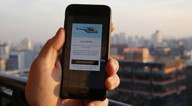 Uber has started a month-long trial of the helicopter service between airports, hotels and convention centres (AP)