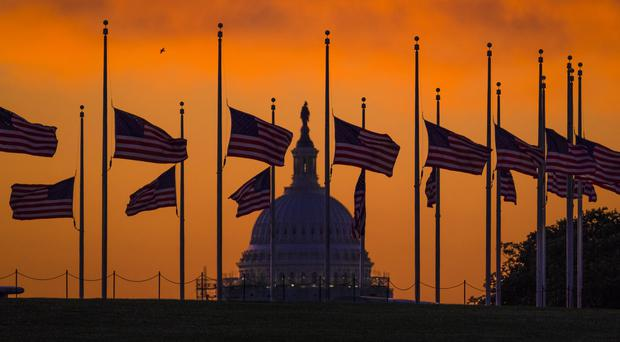 Flags fly at half-mast in Washington to honour the victims of the Orlando nightclub shootings (AP)