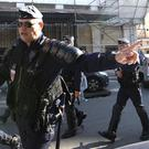 Police officers secure the front of a police station in Marseille, France (AP)