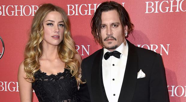 Amber Heard and Johnny Depp were married in 2014, but she filed for divorce last month (AP)
