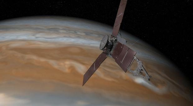 Artist's rendering of the Juno spacecraft above Jupiter (Nasa/JPL-Caltech/AP)
