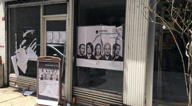 A ripped-up poster advertising the Radiohead event