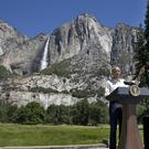 President Barack Obama speaks by the Sentinel Bridge, in the Yosemite Valley, in front of the Yosemite Falls (AP)