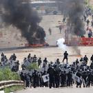 Riot police battle with protesting teachers near the town of Nochixtlan (AP)